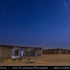 Middle East - GCC - Kuwait - Kuwaiti Desert - Star Trails over ruined old houses in sea of sand dunes of Arabian Desert