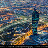 "Middle East - GCC - Kuwait - Kuwait City - View from Al Hamra Tower - Tallest skyscraper in Kuwait - City's Modern Skyline with highrise buildings including Al Tijaria Tower - Kuwait Trade Center inspired by a spiral or helix, body of the tower ""twists"" by 80 degrees as it climbs to 218.2 m / 716 ft at Dusk - Twilight - Blue Hour - Night"
