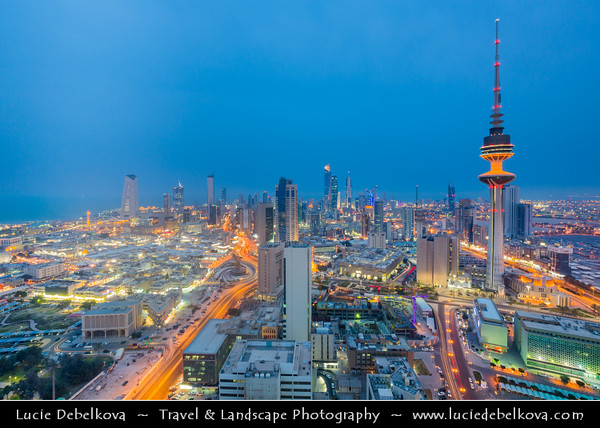 Middle East - GCC - Kuwait - Kuwait City - City's Modern Skyline with high-rise buildings including Liberation Tower - Second tallest structure in Kuwait at Dusk - Twilight - Blue Hour - Night
