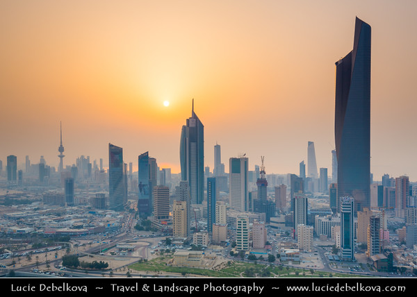 Middle East - GCC - Kuwait - Kuwait City - City's Modern Skyline with highrise buildings including Al Hamra Tower 412.6 m / 1,354 ft - Tallest skyscraper in Kuwait at Sunset