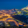 Middle East - GCC - Kuwait - Kuwait City - City's Modern Skyline with highrise buildings including  Kuwait Towers - Group of three slender water towers standing on promontory into the Persian Gulf - Iconic landmark of Kuwait at Dusk - Twilight - Blue Hour - Night
