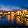 Middle East - GCC - Kuwait - Kuwait City - Souq Shark Marina with boats and City's Modern Skyline with high-rise buildings at Dusk - Twilight - Blue Hour
