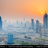 "Middle East - GCC - Kuwait - Kuwait City - City's Modern Skyline with highrise buildings including Al Tijaria Tower - Kuwait Trade Center inspired by a spiral or helix, body of the tower ""twists"" by 80 degrees as it climbs to 218.2 m / 716 ft at Sunset"