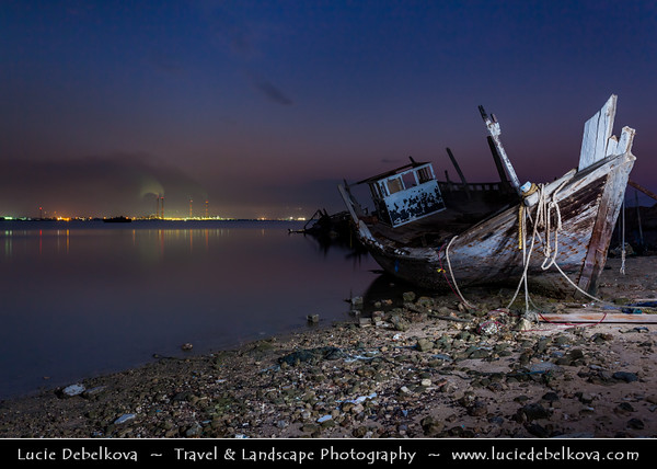 Middle East - GCC - Kuwait - Old Dhow (traditional arab boat) in Al Doha Port in Al-Hishan, part of Kuwait Bay at Dusk - Twilight - Blue Hour - Night