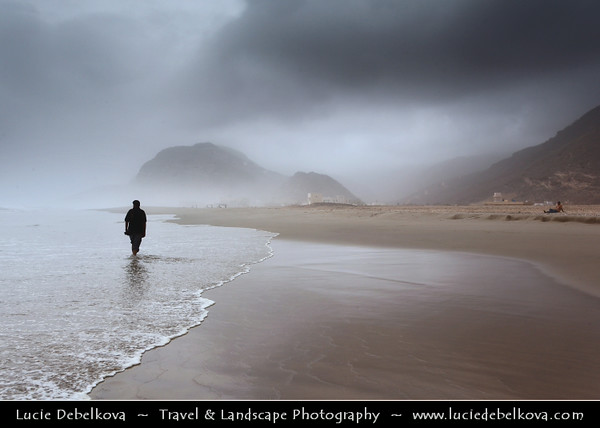 Middle East - Sultanate of Oman - Dhofar Province - Salalah Area - صلالة - Ṣalālah - Rakhyut - Rakhyot - Beach village on scenic coastal location along Indian Ocean surrounded by rugged mountains during Khareef - Rainy Season bringing misty & foggy weather