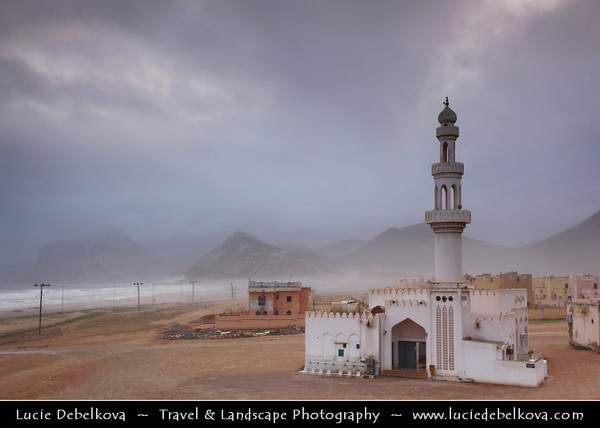 Middle East - Sultanate of Oman - Dhofar Province - Salalah Area - صلالة - Ṣalālah - Al-Mughsayl Beach - Al Maghseel - Mughsail - Maghsail - Scenic coastal location along Indian Ocean with rugged mountains during Khareef - Rainy Season bringing misty & foggy weather - Lonely Mosque