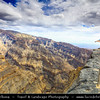 Middle East - Sultanate of Oman - South Batinah Governorate - Hajar Mountains - جبال الحجر‎ - Stone Mountains - Spectacular wall of mountains with dramatic canyons and rocky valleys in northeastern Oman -  Oman's Grand Canyon of Jebel Shams, highest peak in Oman