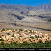 Middle East - Sultanate of Oman - Al Dakhiliyah Governorate - Al Hamra - One of best-preserved old Omani towns with stony, rubble-strewn alleyways lined with endless traditional mudbrick houses tumbling down the hillside to palm trees oasis below