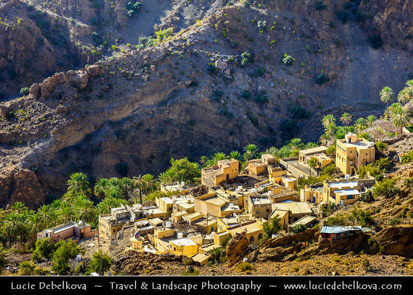 Middle East - Sultanate of Oman - South Batinah Governorate - Hajar Mountains - جبال الحجر - Stone Mountains - Spectacular wall of mountains with dramatic canyons and rocky valleys in northeastern Oman - Wakan - Spectacular mountain village with beautiful terraced gardens overlooking the surrounding mountains above and Wadi Mistal below