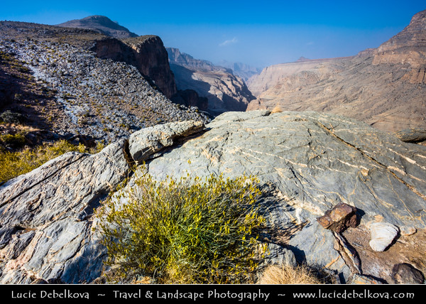 Middle East - Sultanate of Oman - South Batinah Governorate - Hajar Mountains - جبال الحجر - Stone Mountains - Spectacular wall of mountains with dramatic canyons and rocky valleys in northeastern Oman - Area of Jebel Shams, highest peak in Oman