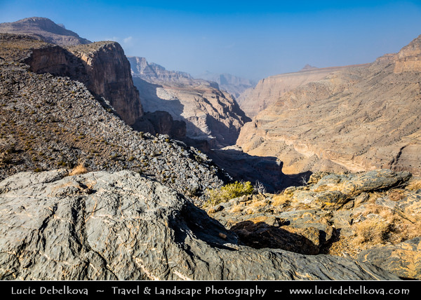 Middle East - Sultanate of Oman - South Batinah Governorate - Hajar Mountains - جبال الحجر‎ - Stone Mountains - Spectacular wall of mountains with dramatic canyons and rocky valleys in northeastern Oman - Area of Jebel Shams, highest peak in Oman