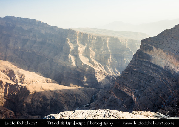 Middle East - Sultanate of Oman - South Batinah Governorate - Hajar Mountains - جبال الحجر - Stone Mountains - Spectacular wall of mountains with dramatic canyons and rocky valleys in northeastern Oman - Wadi Nakhr - Wadi Ghul - Oman's Grand Canyon of Jebel Shams, highest peak in Oman