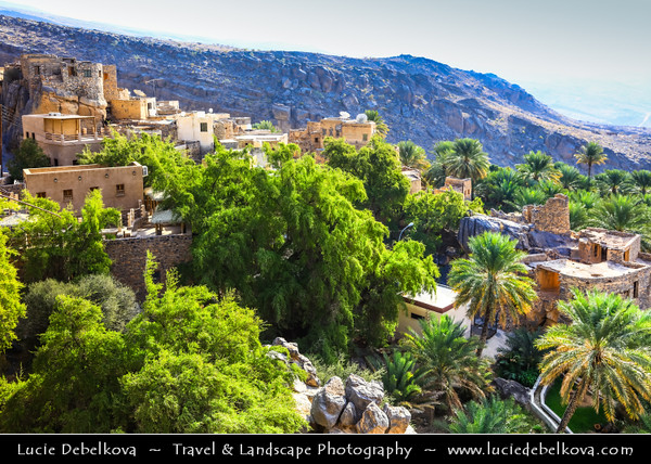 Middle East - Sultanate of Oman - Al Dakhiliyah Governorate - Misfat Al Abriyeen - Misfat al Abryeen - Misfah Al Abriyyin - One of prettiest traditional Omani hilltop villages, picturesque huddle of old ochre-coloured stone buildings along falaj set on edge deep gorge/wadi with green oasis below