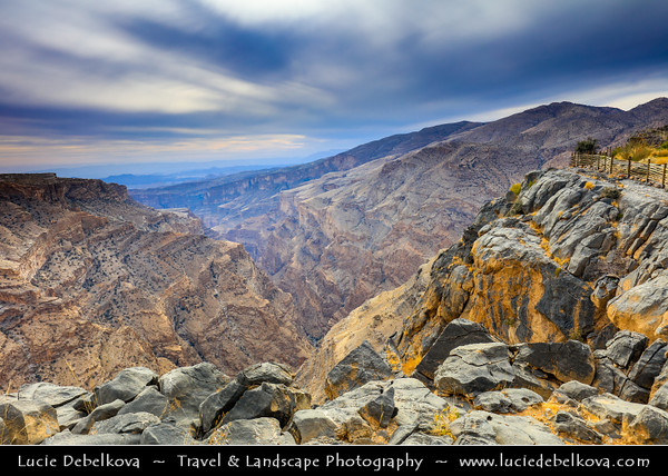 "Middle East - Sultanate of Oman - Hajar Mountains - جبال الحجر‎ - Stone Mountains - Spectacular wall of mountains with dramatic canyons and rocky valleys in northeastern Oman - Jabal Akhdar, meaning ""The Green Mountain"" - 2,000 metres above sea level overlooking  dramatic gorge, surrounded by awe-inspiring views"