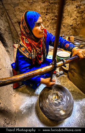 Middle East - Sultanate of Oman - Al Dakhiliyah Governorate - Al Hamra - One of best-preserved old Omani towns with stony, rubble-strewn alleyways lined with endless traditional mudbrick houses tumbling down the hillside to palm trees oasis below - Bait Al Safah - Living museum of old Oman occupying in restored traditional house with old artefacts and traditional furnishings