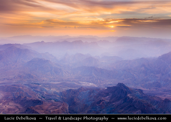 Middle East - Sultanate of Oman - South Batinah Governorate - Hajar Mountains - جبال الحجر‎ - Stone Mountains - Spectacular wall of mountains - Jebel Shams, highest peak in Oman at elevation of 3009 m (9872 ft)