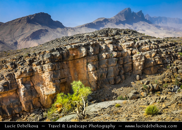 Middle East - Sultanate of Oman - South Batinah Governorate - Hajar Mountains - جبال الحجر‎ - Stone Mountains - Spectacular wall of mountains with dramatic canyons and rocky valleys in northeastern Oman