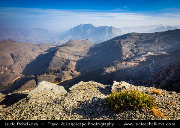 Middle East - Sultanate of Oman - Ad Dakhiliyah Region - Hajar Mountains - جبال الحجر - Stone Mountains - Spectacular wall of mountains with dramatic canyons and rocky valleys in northeastern Oman - Area of Jebel Hat Al Hamra