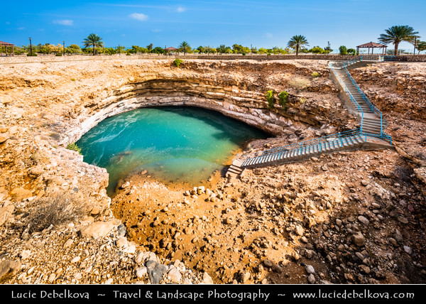 Middle East - Sultanate of Oman - Muscat Governorate - Hawiyat Najm Park - Bimmah Sinkhole - Hawaiyat Najm - Water-filled depression in limestone rock formed by collapse of surface layer due to dissolution of underlying stone - Turquoise water lake 50 m by 70 m wide and approximately 20 m deep
