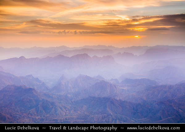 Middle East - Sultanate of Oman - South Batinah Governorate - Hajar Mountains - جبال الحجر - Stone Mountains - Spectacular wall of mountains - Jebel Shams, highest peak in Oman at elevation of 3009 m (9872 ft)