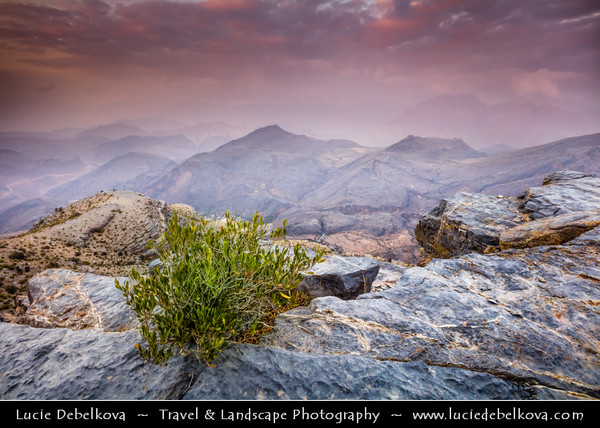 Middle East - Sultanate of Oman - Ad Dakhiliyah Region - Hajar Mountains - جبال الحجر‎ - Stone Mountains - Spectacular wall of mountains with dramatic canyons and rocky valleys in northeastern Oman - Area of Jebel Hat Al Hamra