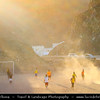 Middle East - Sultanate of Oman - Muscat - مسقط - Masqaṭ - Kids playing football in surrounding mountains at sunset