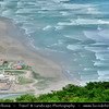 Middle East - Sultanate of Oman - Dhofar Province - Salalah Area - صلالة - Ṣalālah - Rakhyut - Rakhyot - Beach village on scenic coastal location along Indian Ocean surrounded by rugged mountains during Khareef - Rainy Season bringing misty & foggy weather