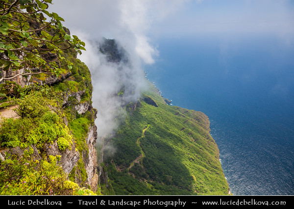 Middle East - Sultanate of Oman - Dhofar Province - Salalah Area - صلالة - Ṣalālah - Scenic coastal location along Indian Ocean surrounded by rugged mountains during Khareef - Rainy Season bringing misty & foggy weather