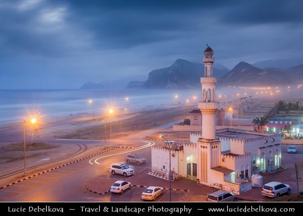 Middle East - Sultanate of Oman - Dhofar Province - Salalah Area - صلالة - Ṣalālah - Al-Mughsayl Beach - Al Maghseel - Mughsail - Maghsail - Scenic coastal location along Indian Ocean with rugged mountains during Khareef - Rainy Season bringing misty & foggy weather - Lonely Mosque at Dusk - Twilight - Night