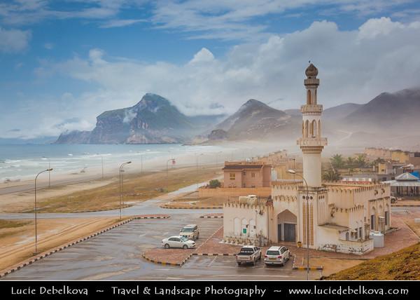 Middle East - Sultanate of Oman - Dhofar Province - Salalah Area - صلالة - Ṣalālah - Al-Mughsayl Beach - Al Maghseel - Mughsail - Maghsail - Scenic coastal location along Indian Ocean with rugged mountains during Khareef - Rainy Season bringing misty & foggy weather