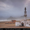 Middle East - Sultanate of Oman - Dhofar Province - Salalah Area - صلالة - Ṣalālah - Al-Mughsayl Beach - Al Maghseel - Mughsail - Maghsail - Scenic coastal location along Indian Ocean with rugged mountains during Khareef - Rainy Season bringing misty & foggy weather - Lonely Mosque