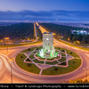 Middle East - Sultanate of Oman - Dhofar Province - Salalah Area - صلالة - Ṣalālah - Salalah Clock Tower roundabout with lines of date palm trees to desert