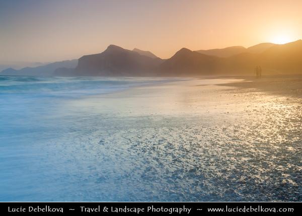 Middle East - Sultanate of Oman - Dhofar Province - Salalah Area - صلالة - Ṣalālah - Al-Mughsayl Beach - Al Maghseel - Mughsail - Maghsail - Scenic coastal location along Indian Ocean with rugged mountains during sunset