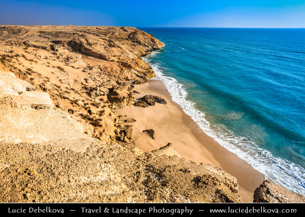 Middle East - Sultanate of Oman - Ash Sharqiyah district - Sur Coast - Rocky cliffes on shores of Indian Ocean