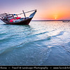 Middle East - Sultanate of Oman - Ash Sharqiyah district - Ras al Hadd - Fishing town located on the east coast of Oman on shores of Indian Ocean - Important ancient trading point between East Africa, Indian subcontinent and Arabian peninsula - Dhows in shallow water of local beach, traditional Arab boats still used for fishing these days - Sunset