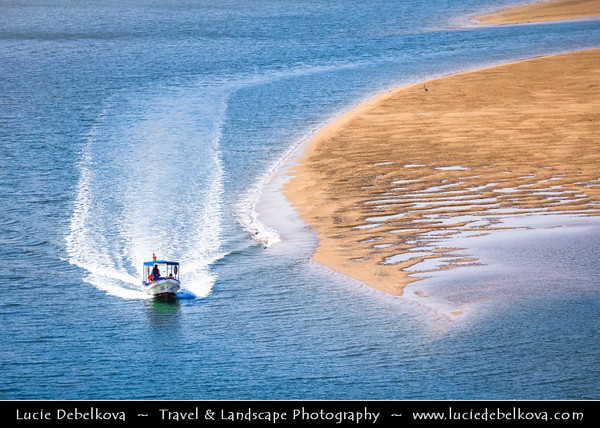 Middle East - Sultanate of Oman - Ash Sharqiyah Region - Sur - صور - One of ancient Omani maritime cities & important destination point for sailors on coast of Gulf of Oman - Fishing boat sailing through sandy lagoon during low tide