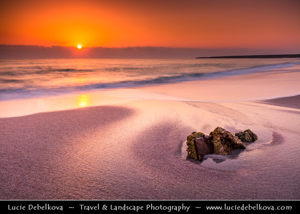 Middle East - Sultanate of Oman - Ash Sharqiyah district - Ras al Hadd - Fishing town located on the east coast of Oman on shores of Indian Ocean - Important ancient trading point between East Africa, Indian subcontinent and Arabian peninsula - Sunrise on the sandy beach