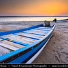 Middle East - Sultanate of Oman - Ash Sharqiyah district - Ras al Hadd - Fishing town located on the east coast of Oman on shores of Indian Ocean - Important ancient trading point between East Africa, Indian subcontinent and Arabian peninsula - Fishing boats on the beach at Sunset