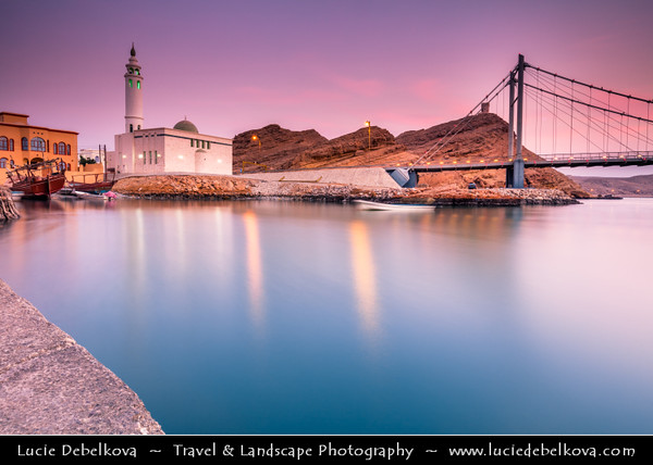 Middle East - Sultanate of Oman - Ash Sharqiyah Region - Sur - صور - One of ancient Omani maritime cities & important destination point for sailors on coast of Gulf of Oman - Iconic mosque on shore of Ayjah Bay next to modern Khour Al Batah Suspension Bridge