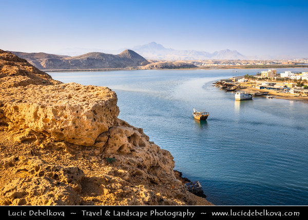 Middle East - Sultanate of Oman - Ash Sharqiyah Region - Sur - صور‎ - One of ancient Omani maritime cities & important destination point for sailors on coast of Gulf of Oman - Dhow, fishing boat in sandy lagoon during low tide