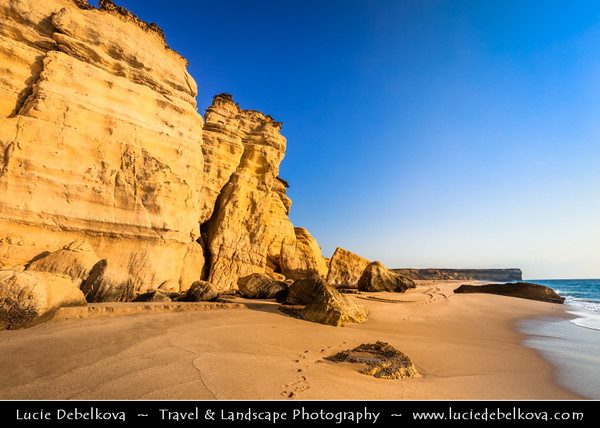 Middle East - Sultanate of Oman - Ash Sharqiyah district - Ras al-Jinz Turtle Reserve - Ras al-Jinz - The easternmost point of the Arabian Peninsula & nesting site for green turtles - Steep cliffs and rocky formations on shore of Indian Ocean