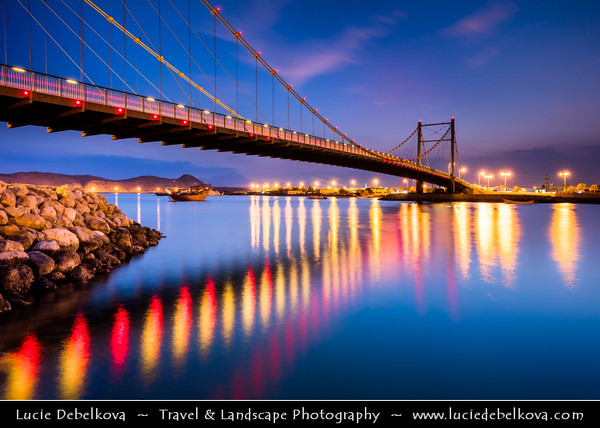 Middle East - Sultanate of Oman - Ash Sharqiyah Region - Sur - صور - One of ancient Omani maritime cities & important destination point for sailors on coast of Gulf of Oman - Cityscape with modern Khour Al Batah Suspension Bridge