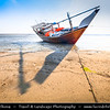 Middle East - Sultanate of Oman - Ash Sharqiyah district - Ras al Hadd - Fishing town located on the east coast of Oman on shores of Indian Ocean - Important ancient trading point between East Africa, Indian subcontinent and Arabian peninsula - Dhows in shallow water of local beach, traditional Arab boats still used for fishing these days
