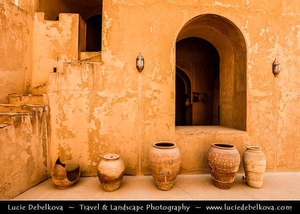 Middle East - Sultanate of Oman - Al Dakhiliyah Governorate - Welayat Bahla - Jibrin town - Jibreen Castle - Jabreen Castle - Beautiful historic castle withstunning interiors constructed in the late 17th century - Interior design features decorated windows, wooden balconies, arches with inscribed Arabic calligraphy, and breathtaking ceiling artwork