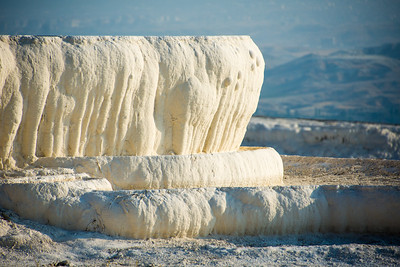 The travertine creates forms that resemble cascading icicles.