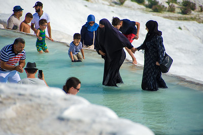 Even a burka won't keep this woman from enjoying the water.