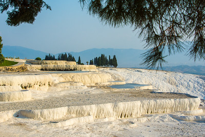 The travertine creates forms that resemble cascading snow and icicles.
