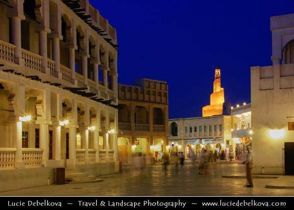 Middle East - GCC - Qatar - Doha - الدوحة - ad-Dawḥa - ad-Dōḥa - Souq Waqif - Souk Wakif - Shopping destination built in traditional architectural Qatari style &  Fanar - Spiral Minaret of Doha Islamic Center - Dusk - Twilight - Blue Hour - Night