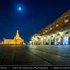 Middle East - GCC - Qatar - Doha - الدوحة‎ - ad-Dawḥa - ad-Dōḥa - Souq Waqif - Souk Wakif - Shopping destination built in traditional architectural Qatari style &  Fanar - Spiral Minaret of Doha Islamic CenterMiddle East - GCC - Qatar - Doha - الدوحة‎ - ad-Dawḥa - ad-Dōḥa - Souq Waqif - Souk Wakif - Shopping destination built in traditional architectural Qatari style &  Fanar - Spiral Minaret of Doha Islamic Center - Dusk - Twilight - Blue Hour - Night - Full Moon