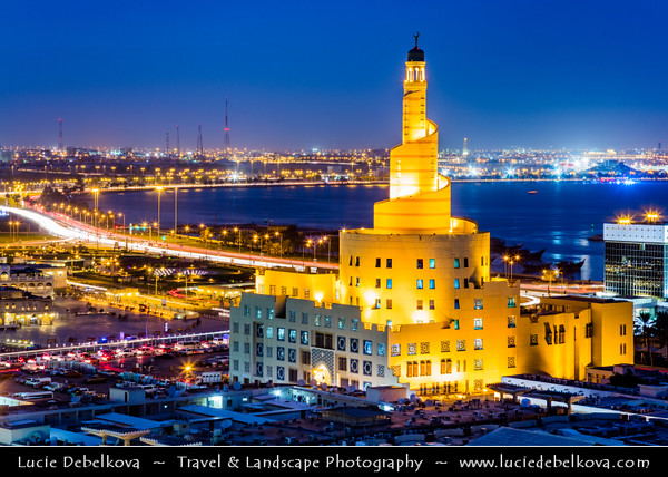 Middle East - GCC - Qatar - Doha - الدوحة‎ - ad-Dawḥa - ad-Dōḥa - Cityskyline with Fanar - Spiral Minaret of Doha Islamic Center with Souq Waqif - Souk Wakif  behind